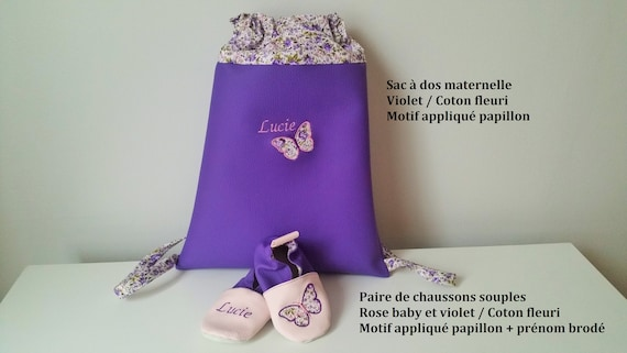 Set consisting of a maternal backpack and a pair of soft slippers