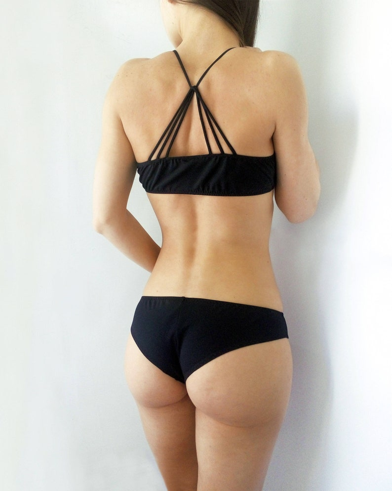 75691cdce Black strappy swimsuit Scrunched bottom Strappy top Hipster