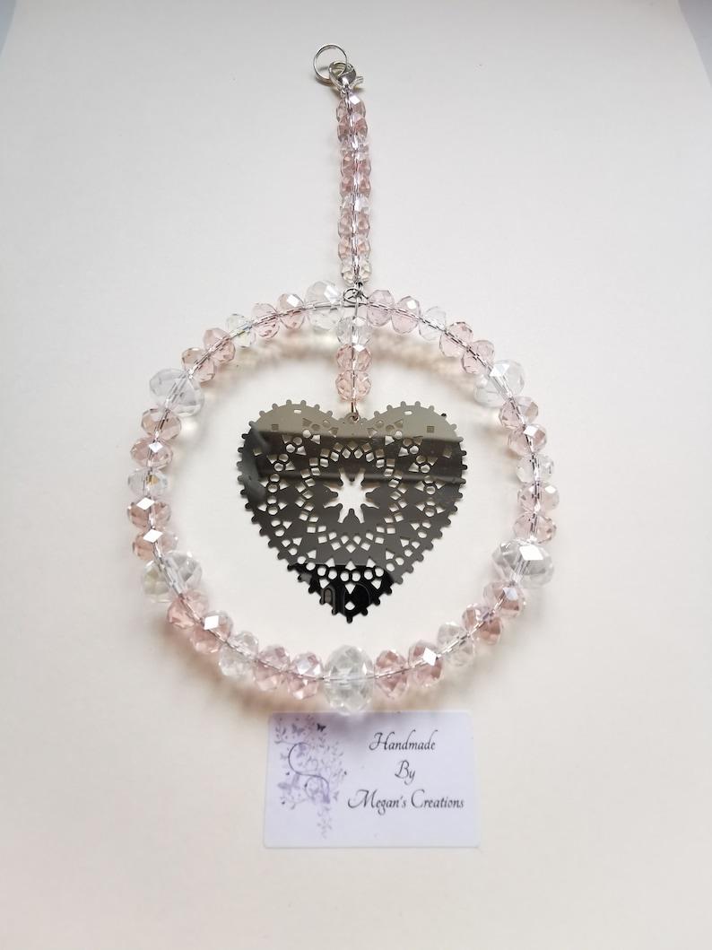 Silver coloured heart beaded suncatcher made in various colours Heart beaded suncatcher Heart suncatcher
