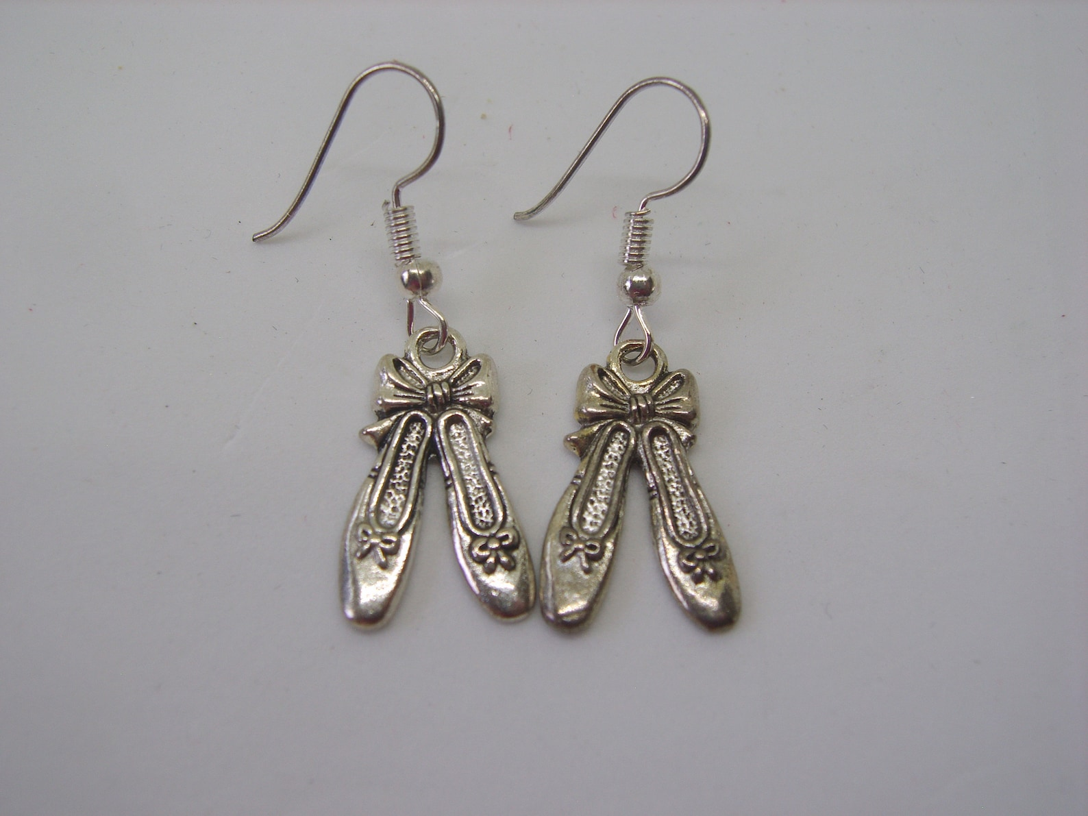 silver plated ballet shoe earrings, ballet shoe earrings, silver plated earrings