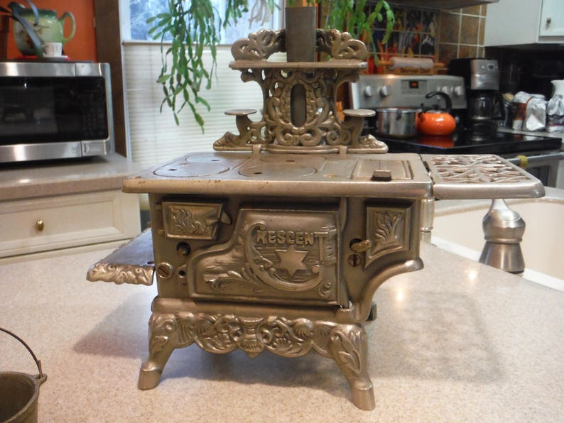 Antique American Cast Nickel Crescent Toy Stove 1900 image 0