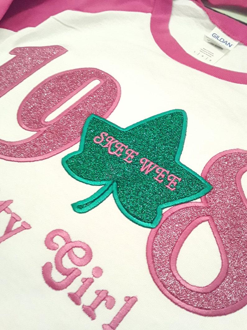 AKA embroidered tackle twill and glitter flake tee