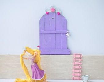 Lilac door with stars and small mushroom
