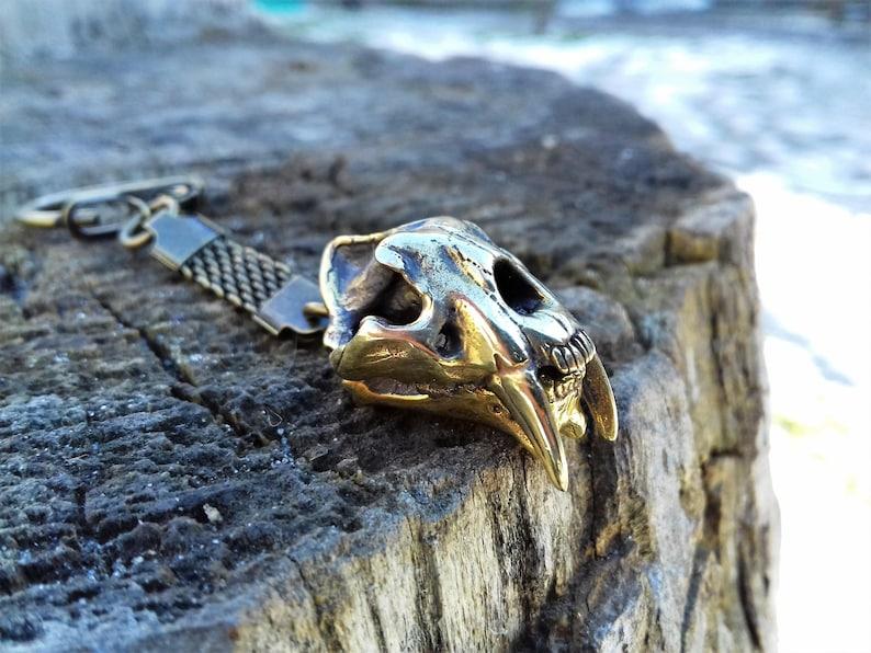 0c87a1ac687 Porte-clé tête de mort du dinosaure Smilodon porte-clé tigre