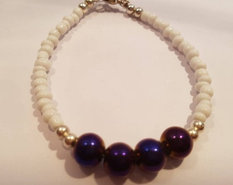 Purple beaded bracelet with white seed beads