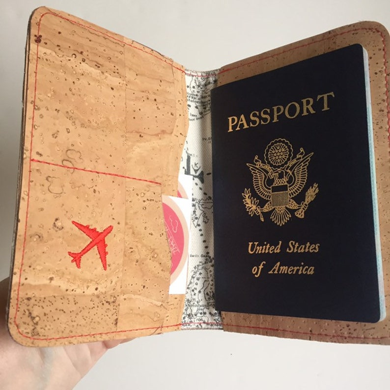 Wrap your passport in this durable cork case Natural Cork Passport Travel Wallet Embroidered Compass Rose with credit card pockets