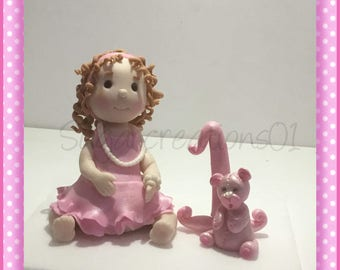 Fondant toddler girl with teddy bear and number