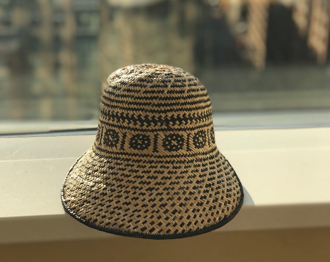 Two toned rattan hand made natural and black woven cap styles hats