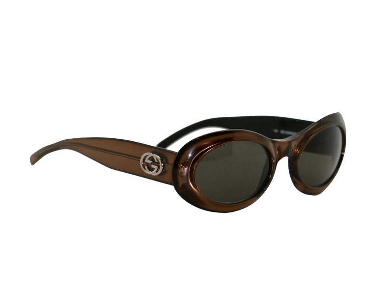 76c734833b8 Gucci Oval sunglasses