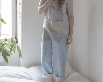 Oversized, naturally dyed, pale blue overalls.