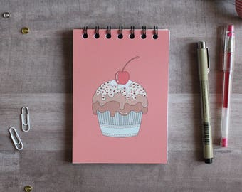 NOTEPAD. A6 Cute Muffin Spiral Notepad. Soft 300 gsm Card Cover. 120 blank pages. Matte lamination pleasant to the touch.