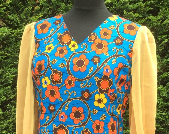 Blue Dutch wax print, princess seamed dress, with Cationic caress gold chiffon sleeves