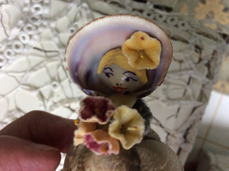 REDUCED with Bonnet and Tiny Fabric Flowers Adorable! Painted Face Vintage Miniature Shell Doll on Small Doily