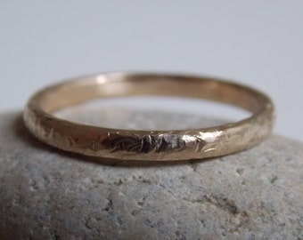 Yellow Gold with a hammered crinkle effect