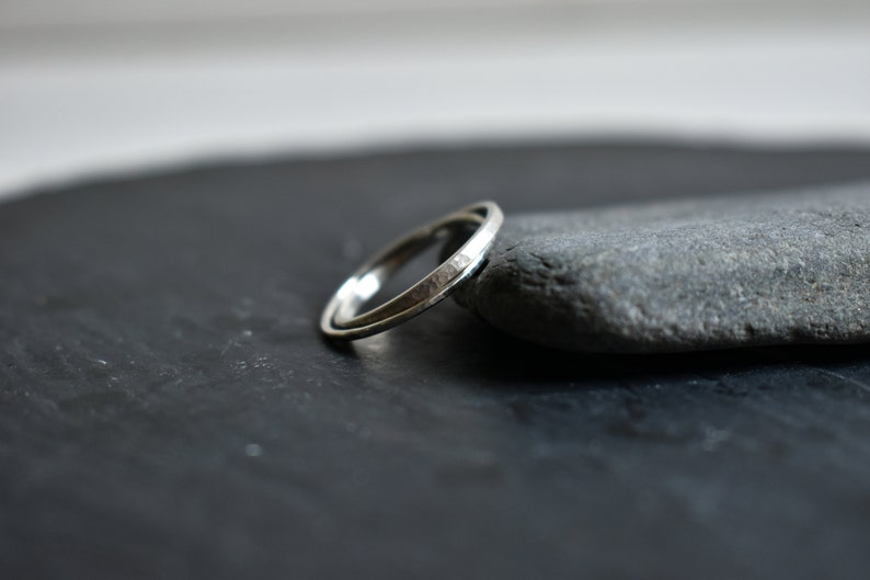 Interlaced engagement rings made of silver.