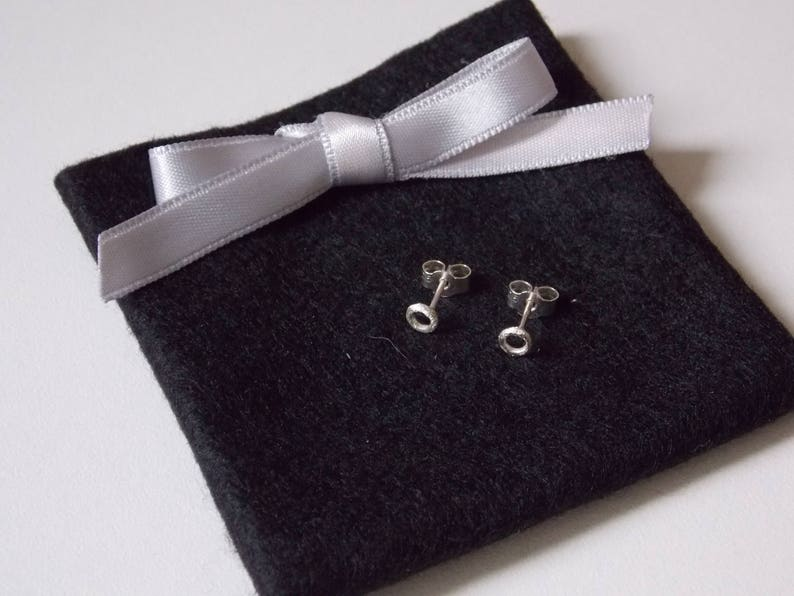 circle ear studs in silver with a sandblasted effect