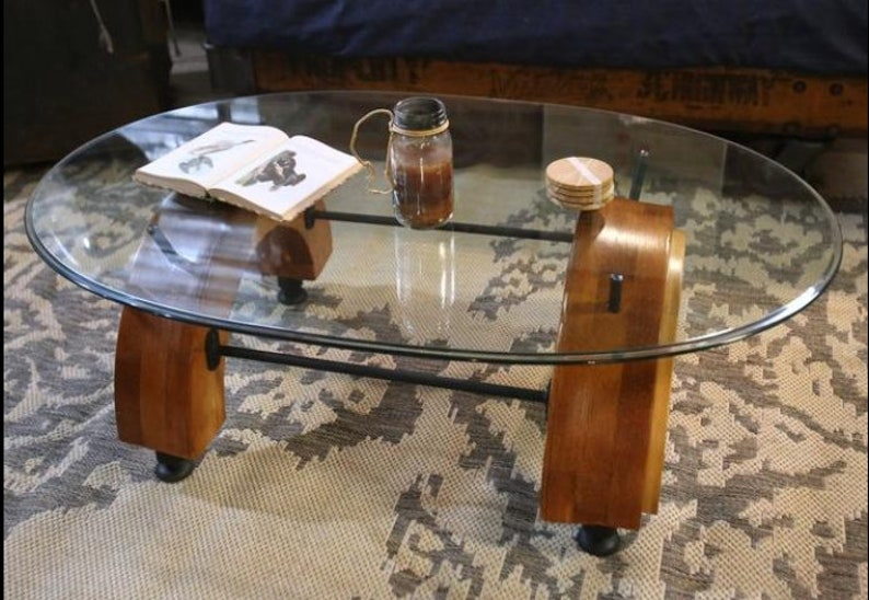 Reclaimed Wood Tire Mold Coffee Table With Oval Glass Top