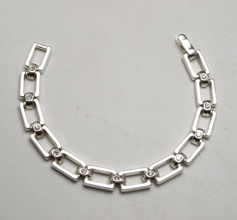Silver bracelet with faux diamonds