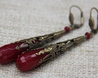 Jade teardrop earrings in antiqued brass filigree finish