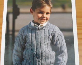 """Vintage knitting pattern for a child's round neck sweater with cable design.  In sizes 22-32"""" chest and knitted in double knit yarn"""