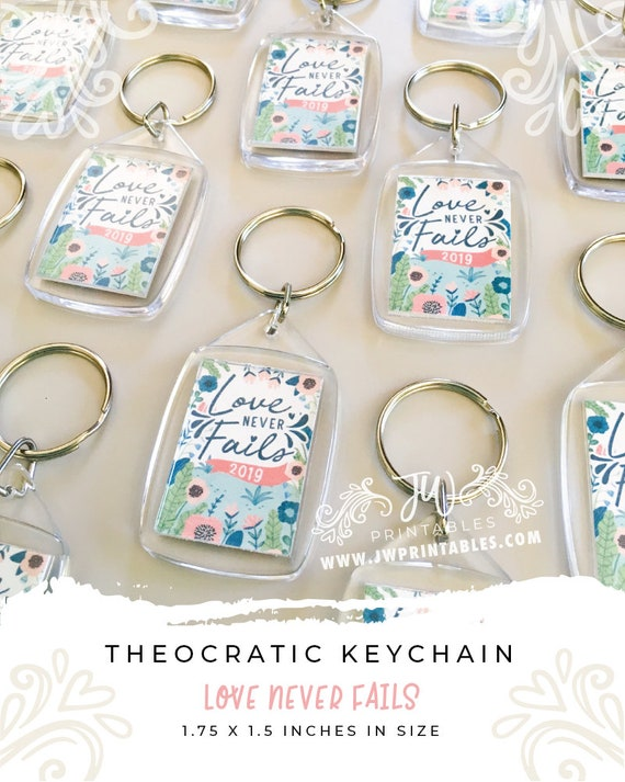 Love Never Fails Keychains (White)   JW Convention Keychains   JW  Convention Gifts - Love Never Fails Gifts - Best Life Ever