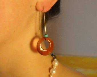 Carnelian long dangle earrings witth a turquoise pop of color.