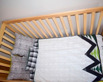 Modern paper pieced tree/mountain crib quilt