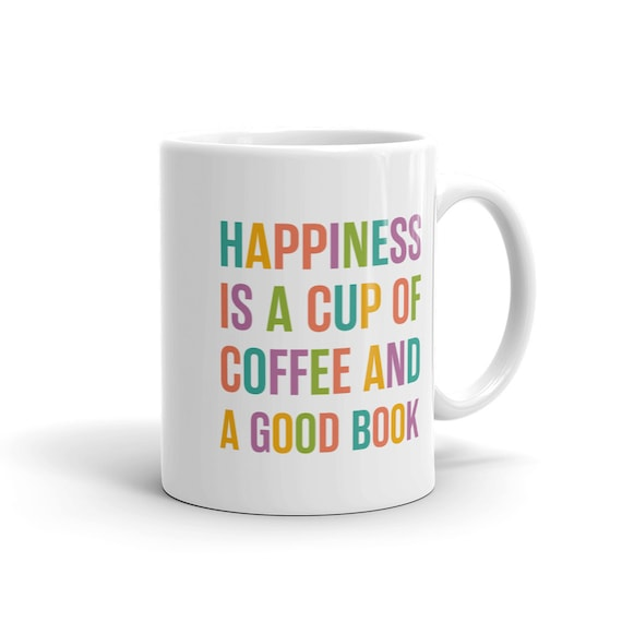white ceramic mug happiness is a cup of coffee and a