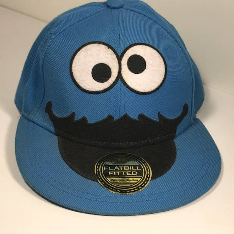4a28f8b9 VINTAGE BASEBALL HAT cap original sticker tag on bill Cookie Monster blue  Sesame Street flatbill fitted L/Xl large extra