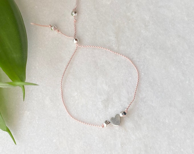 Pale pink germani nylon yarn friendship bracelet with silver heartSt-valentine
