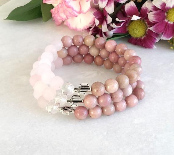 rhodonite bracelet benefits, pale pink rhodonite jewelry, mala rhodonite, rhodonite stone benefits, rhodonite jewelry