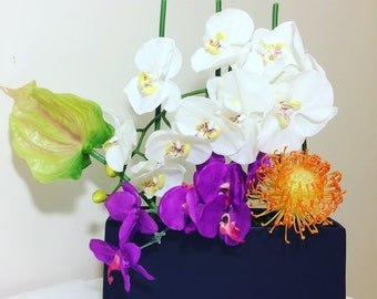 Phalaenopsis orchid arrangement.
