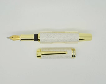 Hand turned fountain pen in Mistral Lunas Corian solid surface material with gold color finish.