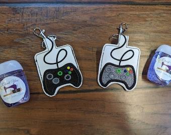boys. Gamer control.girls Orange game controller,kids sanitizer game controller Embroidered hand sanitizer holder.Mini sanitizer holder