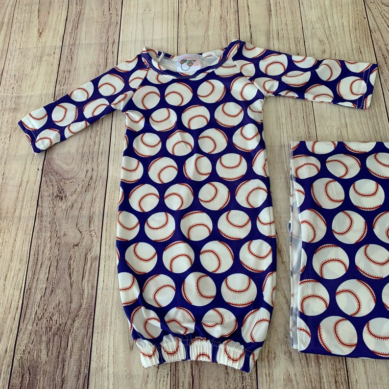 Matching baseball swaddle blanket and baby gown gift set