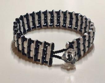 Momochrome beaded bracelet with Swarovski element crystal heart button fastening.