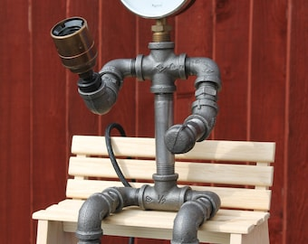 Steampunk lamp, figure sat on a simple wooden bench, provides a talking point wherever it sits.