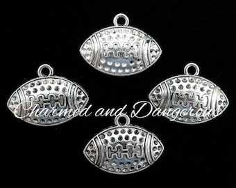 7 pewter Textured Football charms (CM23)
