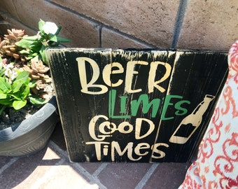Beer, limes, good times sign