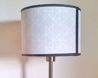 """Pastel blue cylindrical lampshade, geometrical pattern. 20x15cm (approx 8""""x6"""")."""