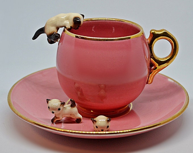 Pink Cup And Saucer With Siamese Miniatures, Porcelain Cat Figurines