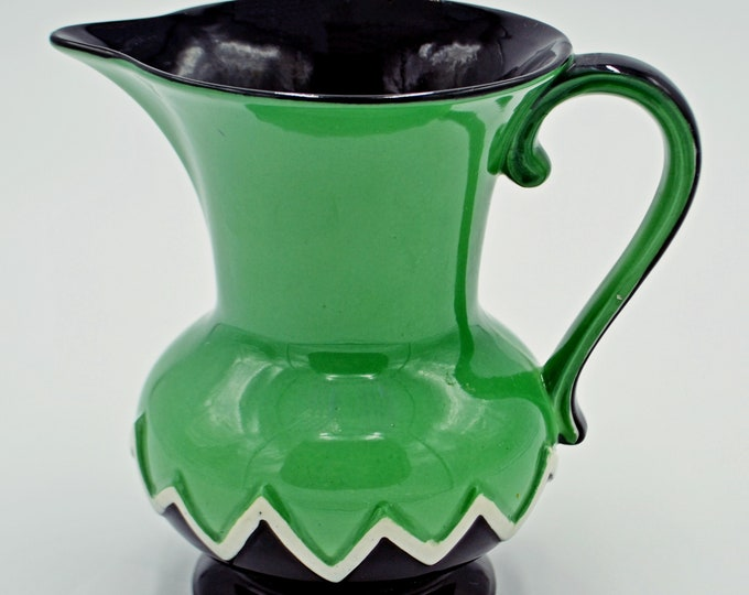 Falcon Ware Jug, Green And Black Pitcher