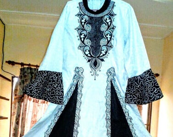 Beautiful white and black robe with an African flair and cross embroidery.