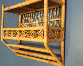 Vintage bohemian rattan and wicker shelf with towel holder