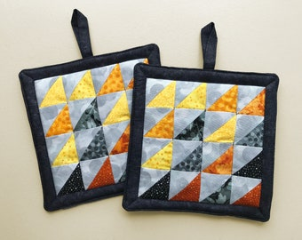 Quilted Pot Holders, Black Gray Yellow Orange Interesting Designer Fabrics, Set of Two Hot Pads, Artistic Triangles Mosaic with Black Border