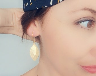Gold leather leaf earrings and GOLD stamp model AVA