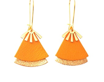 Mustard yellow leather earrings and gold stellar model