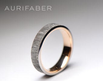Titanium ring with golden inside. Titanium ring and yellow gold, red rosé gold or white gold inside. 5mm wide band.