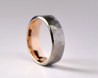 Forged titanium ring with gold inside. Rough surface titanium band with yellow gold or rosé gold. Two-tone band. 7mm wide.