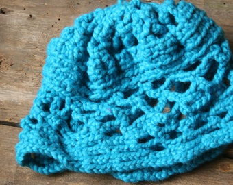 Wool hat made with turquoise crochet technique